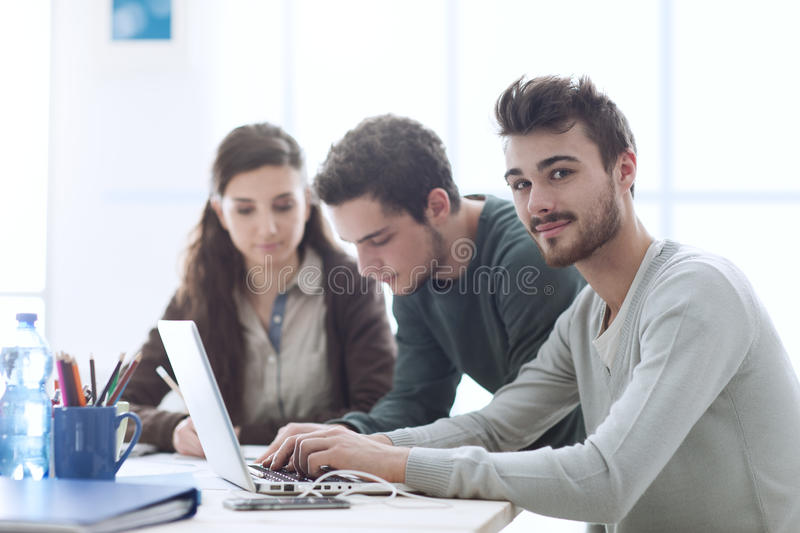 Group of students networking royalty free stock photos