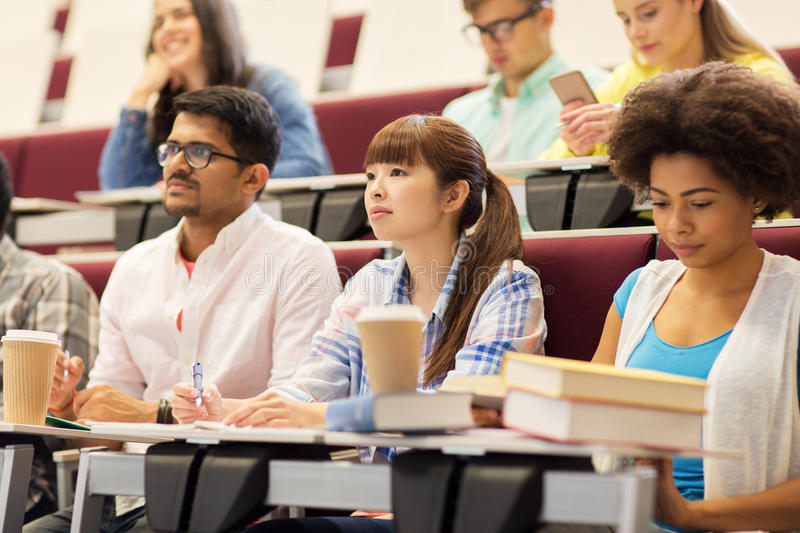 Group of students with notebooks on lecture stock image