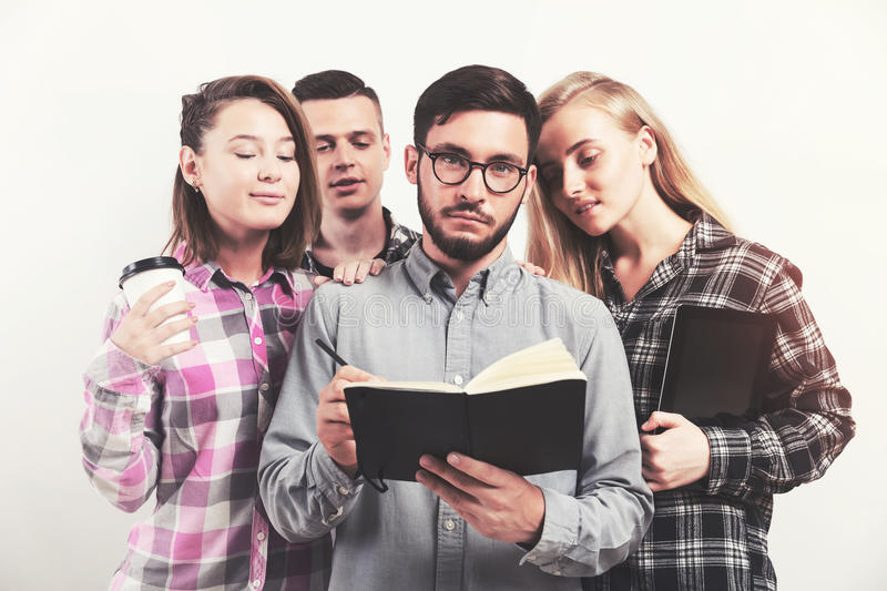 Group of students reading a book stock photos