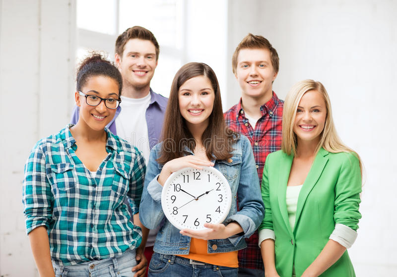 Download Group Of Students At School With Clock Stock Photography - Image: 33187332