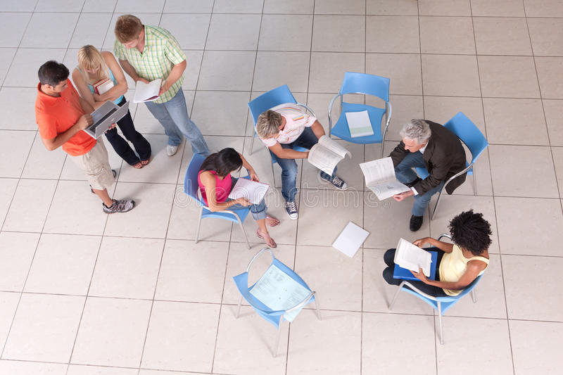 Group Of Students Sitting Down With Lecturer Royalty Free Stock Photography