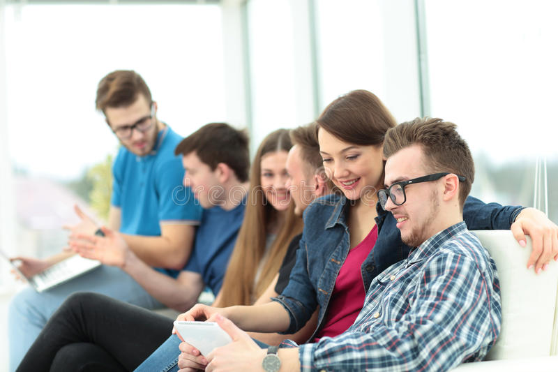 Group of students sitting in the lobby of the University, and to royalty free stock images