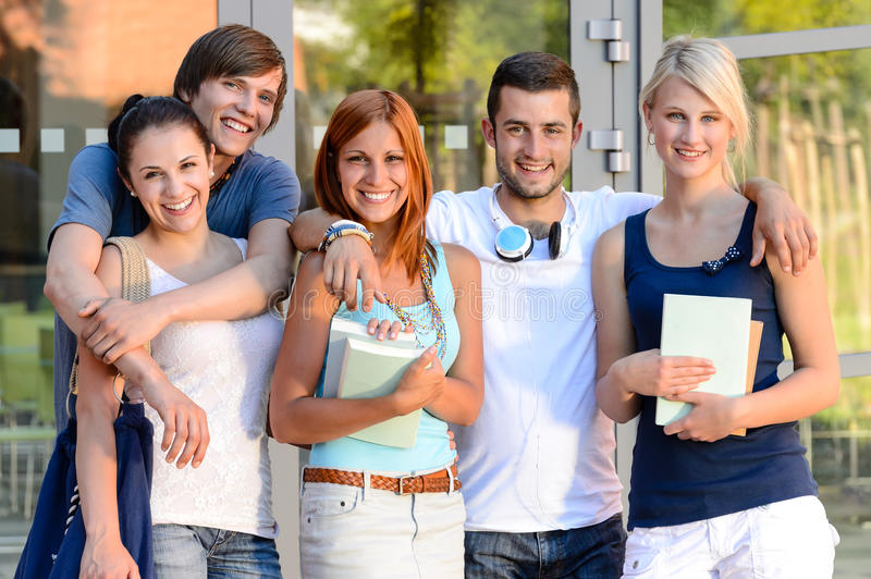 Group of students standing front college campus royalty free stock photo