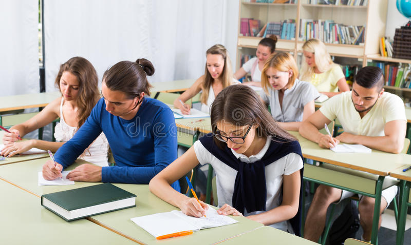 Group of students studying in classroom royalty free stock image
