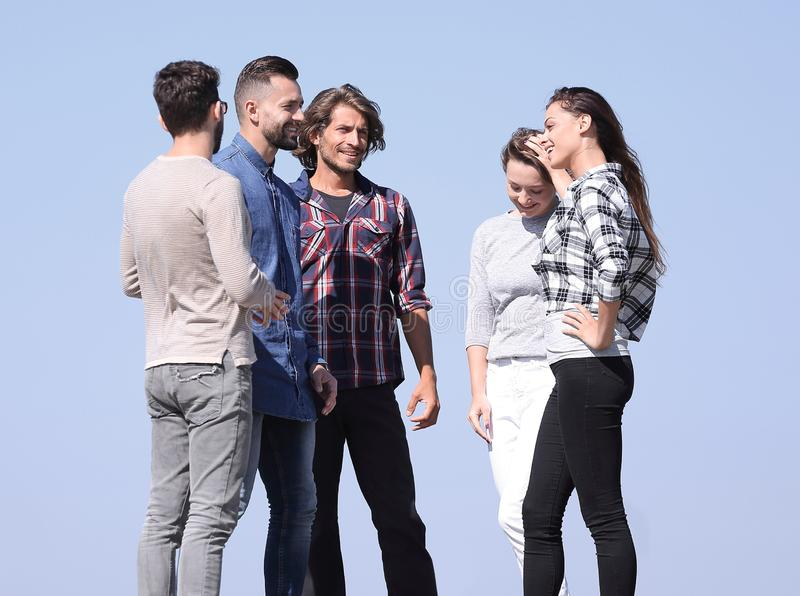 Group of students talking while standing outdoors stock photos