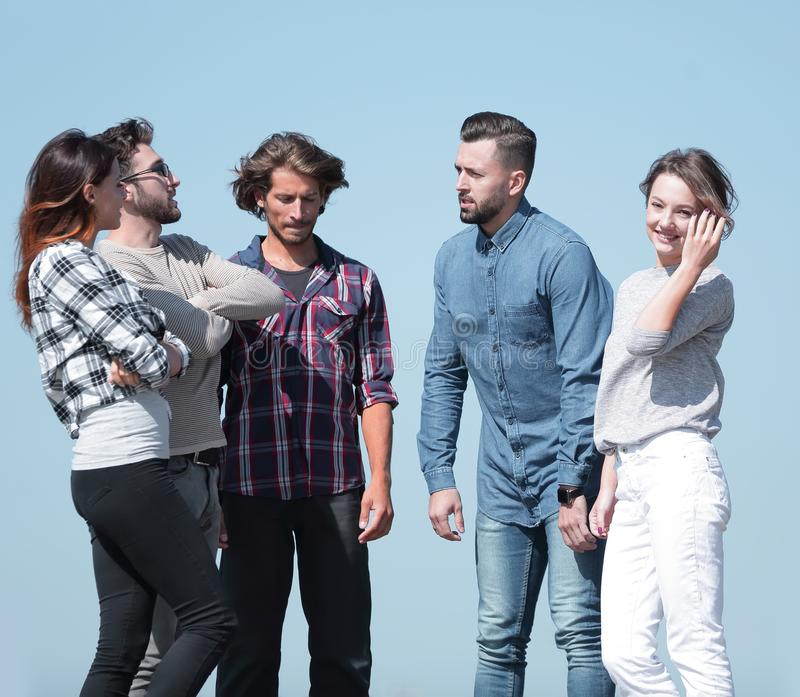 Group of students talking while standing outdoors stock image