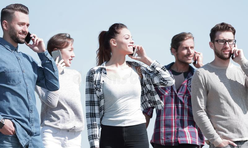 Group of students talking on their smartphones. Photo with copy space royalty free stock photos