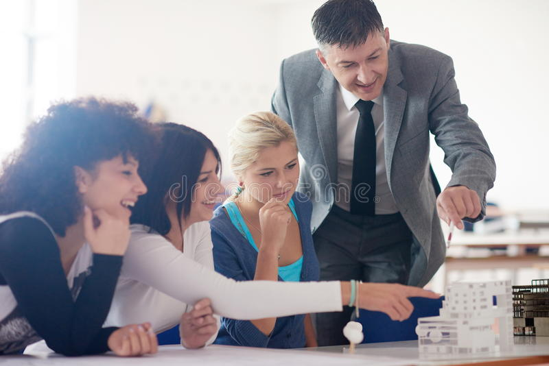 Group of students with teacher on class stock photos