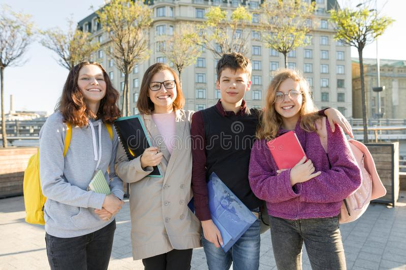 Group of students with teacher, teenagers talking to a female teacher. Outdoor portrait stock photography