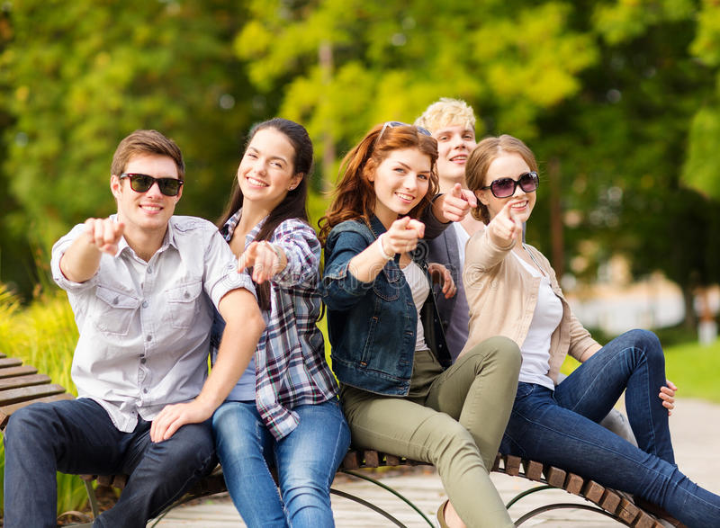 Group of students or teenagers pointing fingers stock photo