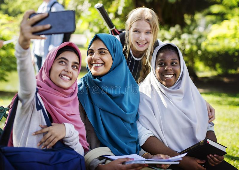 Group of students using mobile phone stock photography