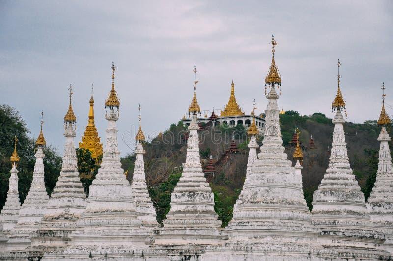 Group of stupas in Sanda Muni Paya temple of Mandalay. Group of stupas in Sanda Muni Paya temple of Mandalay, Myanmar stock photography