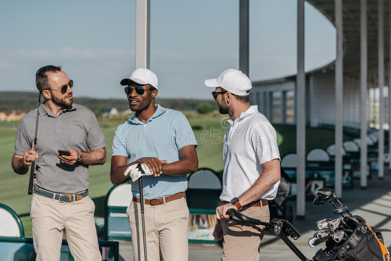 Group of stylish golf players talking before game royalty free stock photos