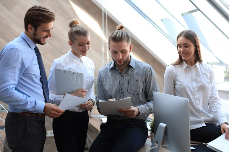Group of successful business people on the background of the office stock image
