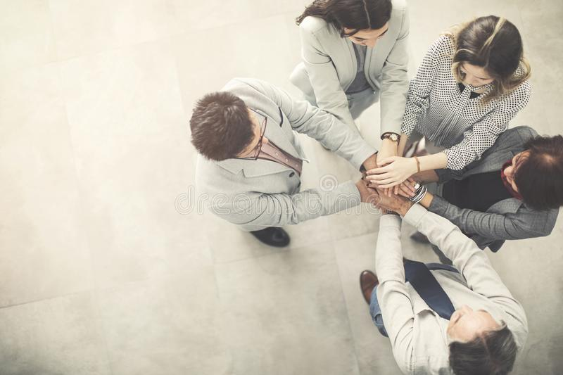 Group of successful business people hand to hand stock image