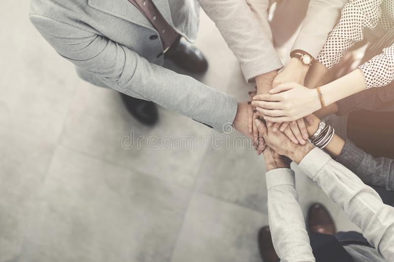 Group of successful business people hand to hand royalty free stock photos