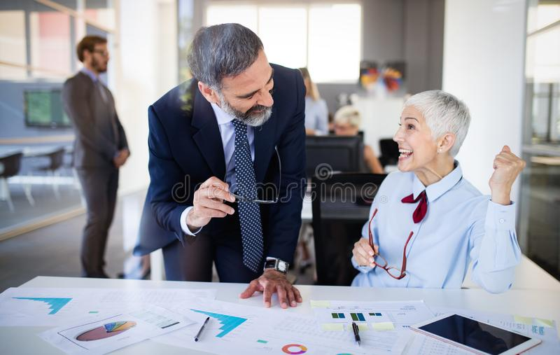 Group of successful business people happy in office stock images