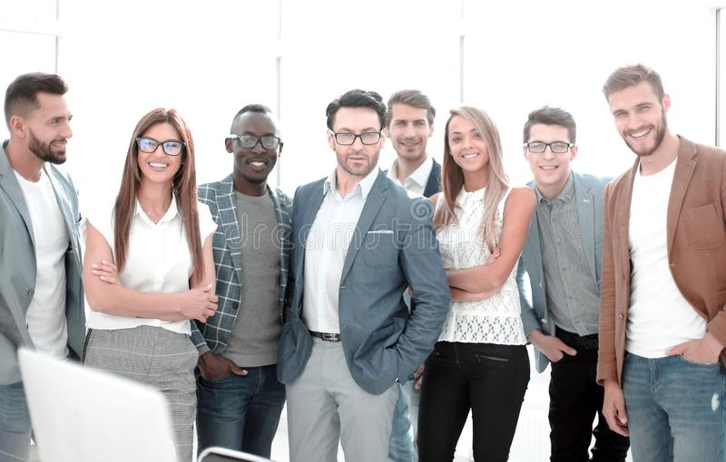 Group of successful business people standing in the office royalty free stock images