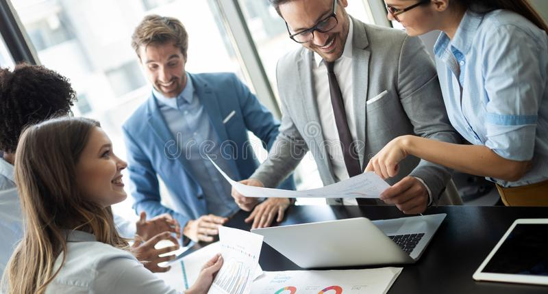 Group of successful business people at work in office stock photos