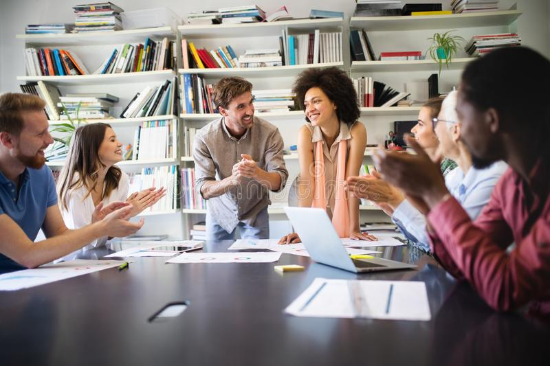 Group of successful business people at work in office stock photo