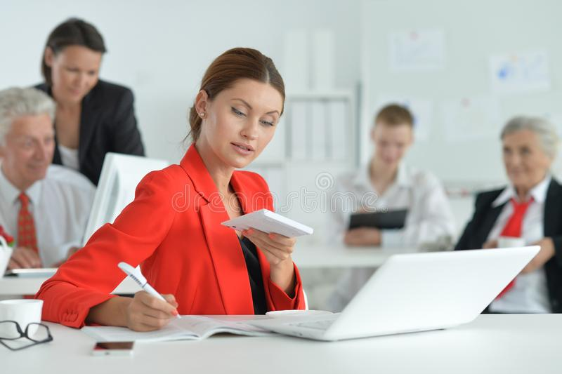 Group of successful business people working in modern office stock photography