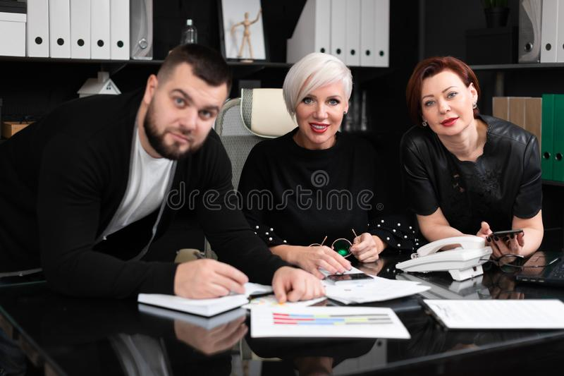 Smiling employees talking in workplace royalty free stock image