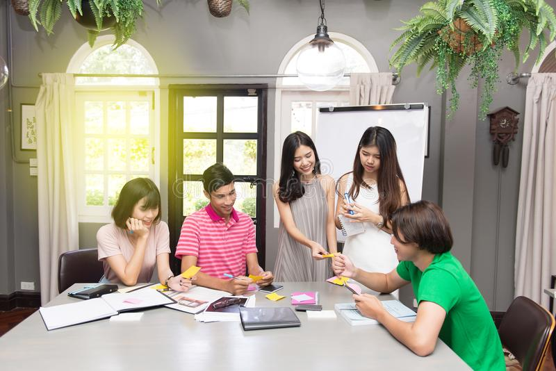 Group of successful freelancers is celebrating working together sitting royalty free stock photos