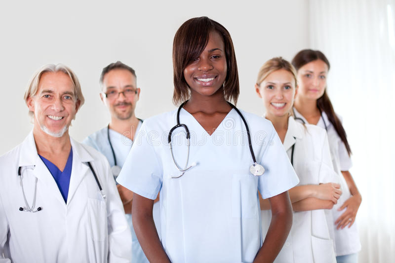 Group of successful happy multi-ethnic doctors. Friendly group of successful happy multi-ethnic doctors smiling at the camera royalty free stock photos