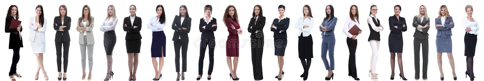 Group of successful young businesswoman standing in a row. Isolated on white background royalty free stock photo