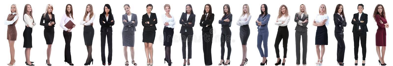 Group of successful young businesswoman standing in a row. Isolated on white background royalty free stock photography