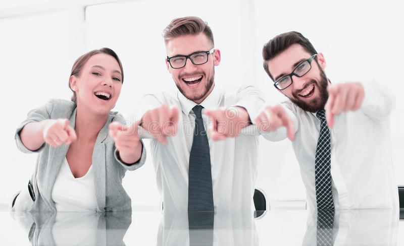Group of successful young men pointing at you stock image