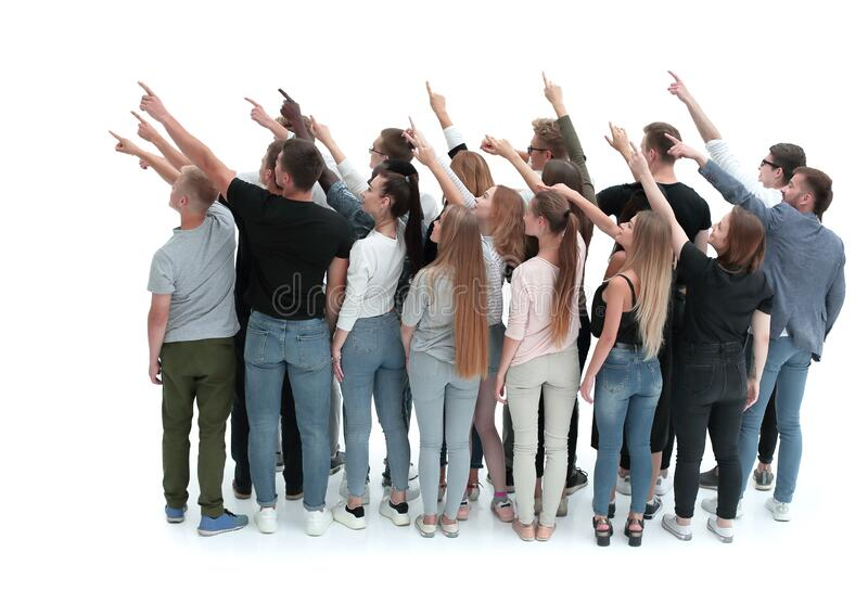 Group of successful young people pointing in one direction royalty free stock photo