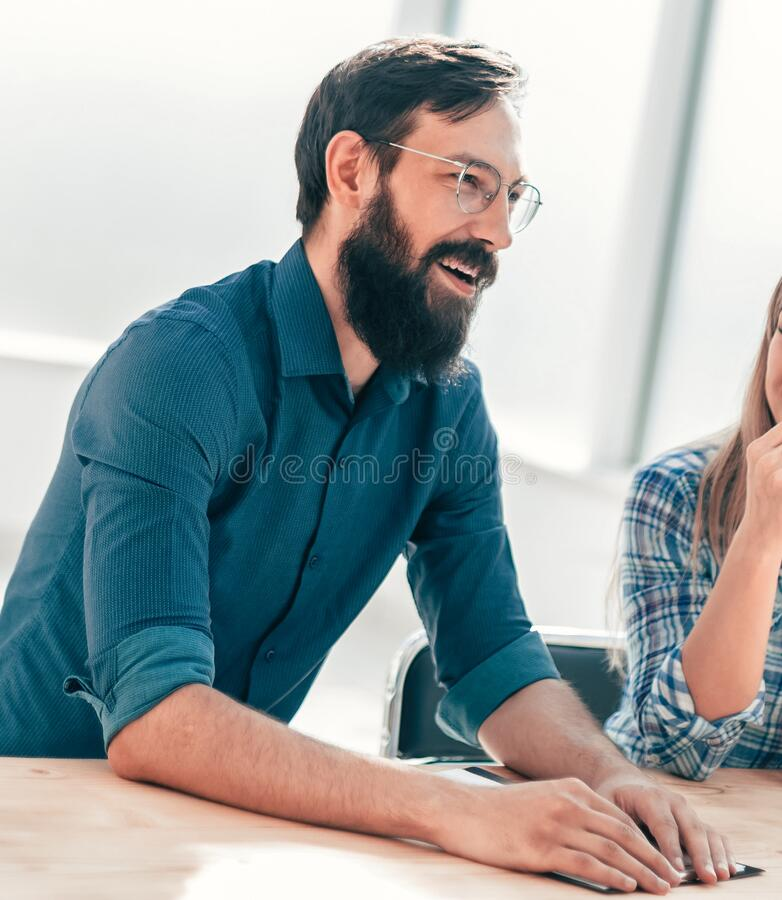 Group of successful young people sitting at the negotiating table. royalty free stock photo