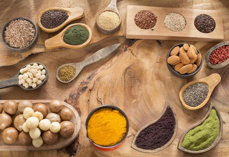 Healthy superfood collection. Seeds, spices, fruits and cereals stock photos
