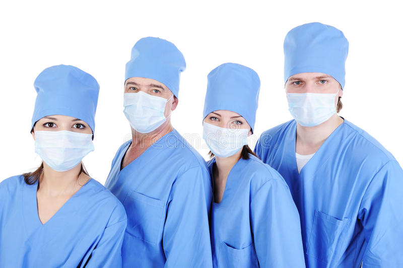Group of surgeons in medical blue uniform. Surgeons in medical blue uniform standing in line - isolated on white background stock images
