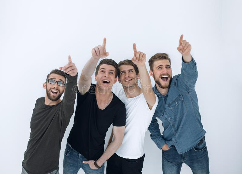 Group of surprised young people looking and pointing up stock photography