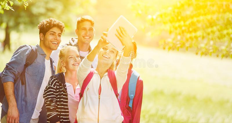 Group taking salfie in the park royalty free stock image