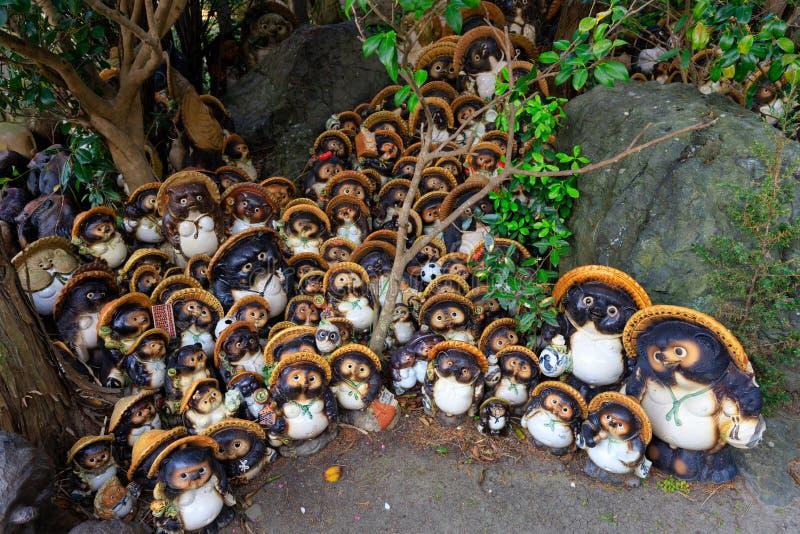 Group of Tanuki statues. Bunch of Tanuki statues in the Awashima Jinja temple, Wakayama, Japan stock photos