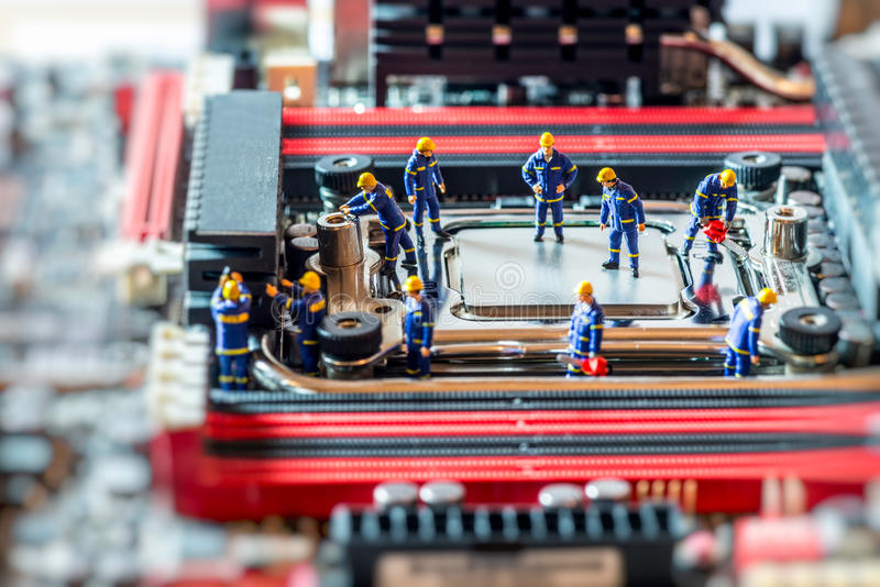 Group of Technicians repairing CPU. Technology concept. Macro photo royalty free stock photography