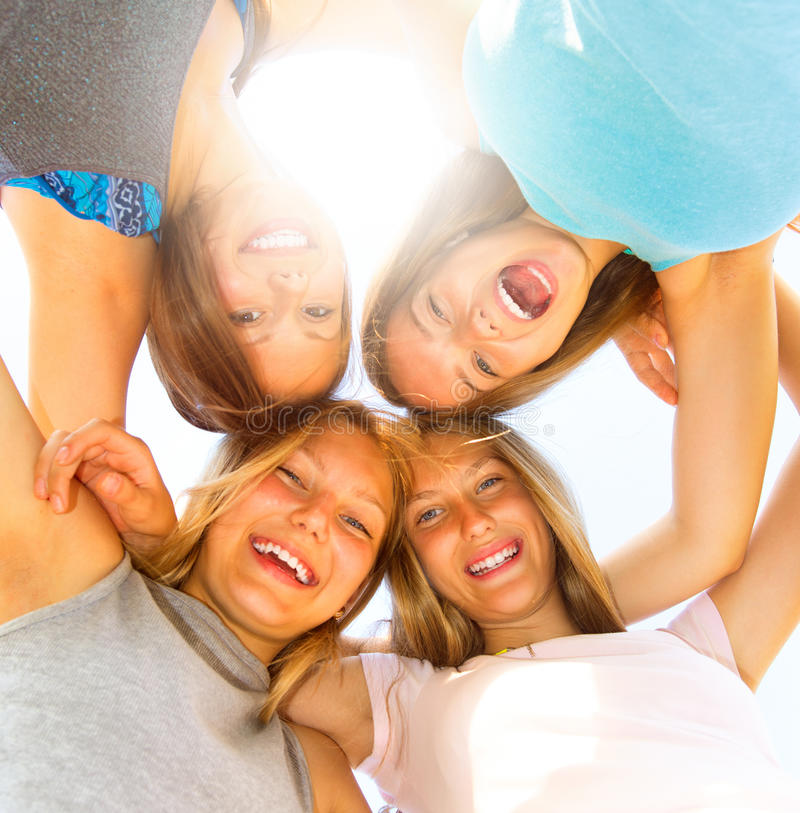 Group of teen girls having fun outdoors. Over blue sky royalty free stock images