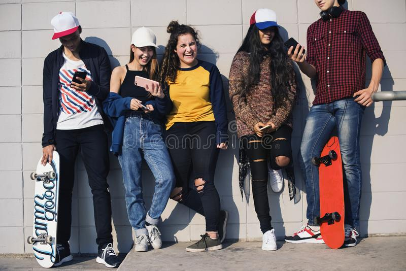 Group of teenage friends outdoors lifestyle and social media concept stock image