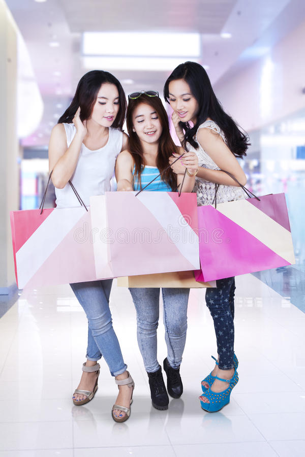 Group of teenage girl shopping together royalty free stock photos