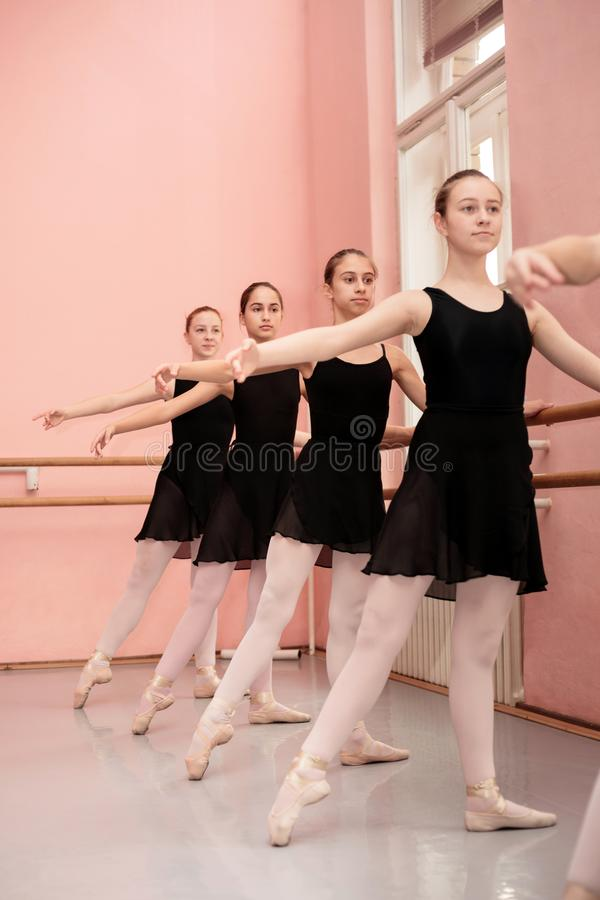Group of teenage girls practicing classical ballet royalty free stock photography