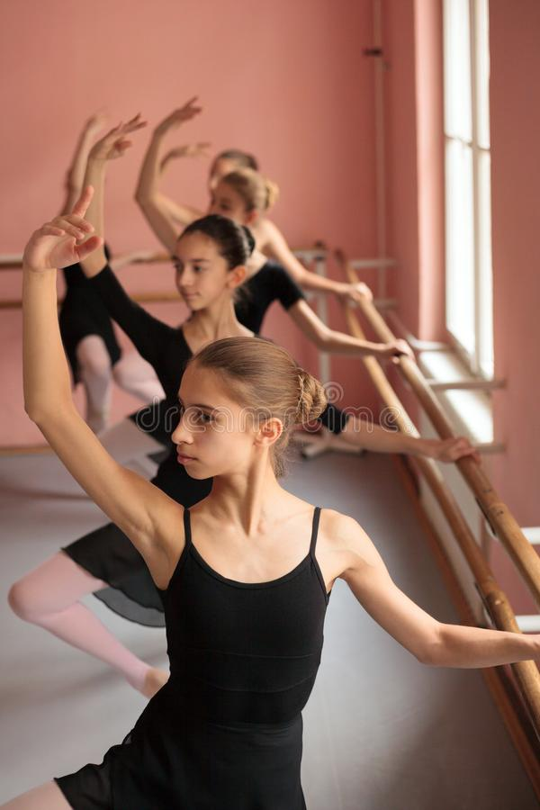 Group of teenage girls practicing classical ballet royalty free stock photos