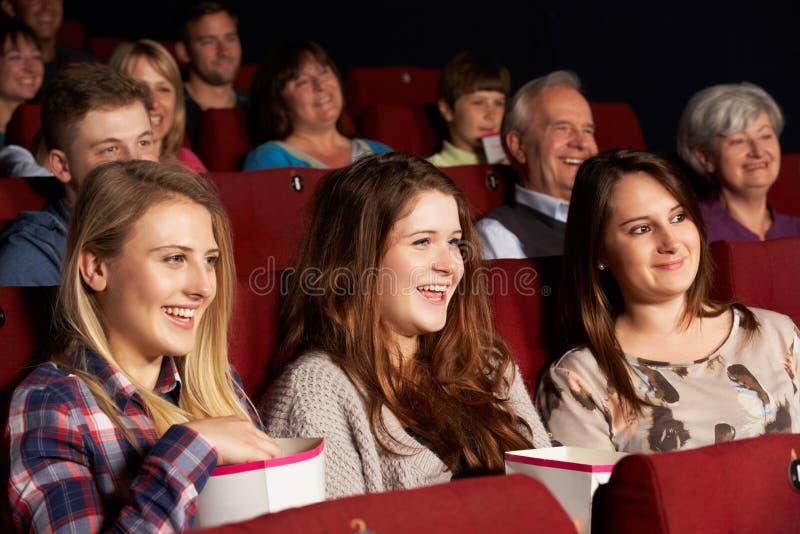 Group Of Teenage Girls Watching Film In Cinema royalty free stock images