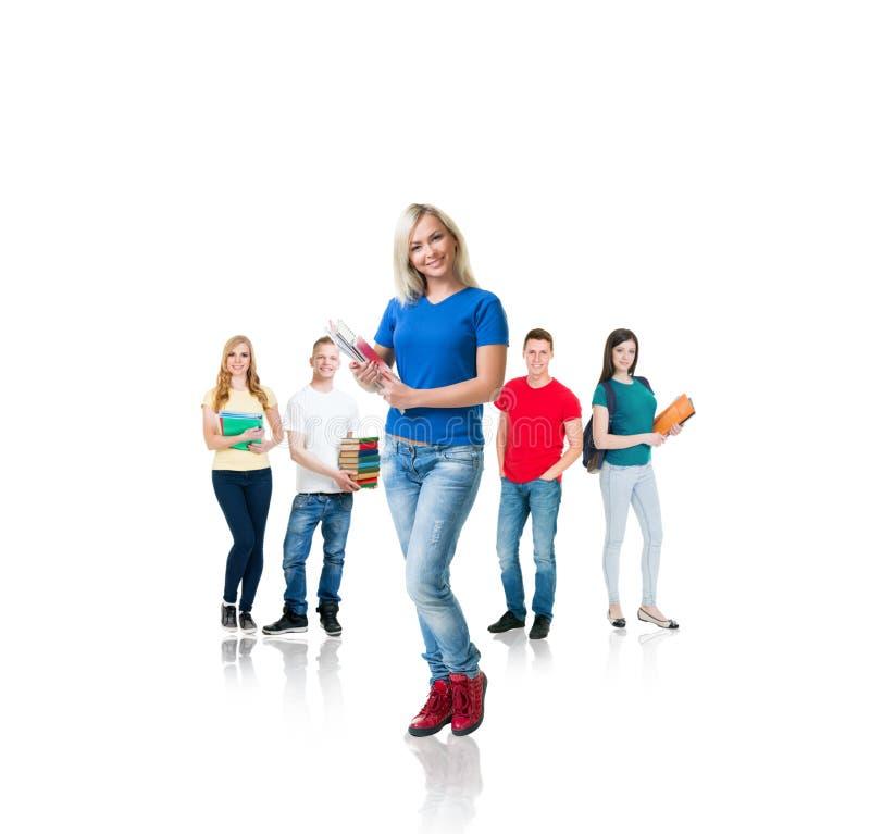 Group of teenage students isolated on white stock image