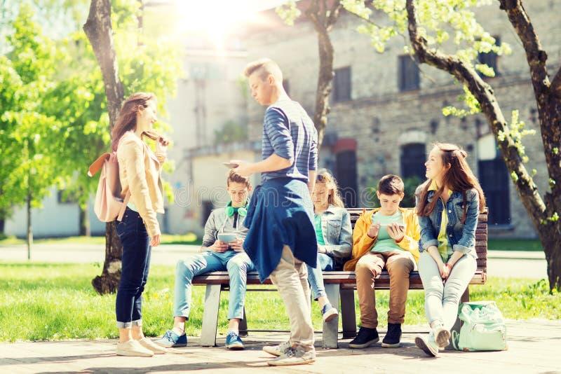Group of teenage students at school yard stock photo
