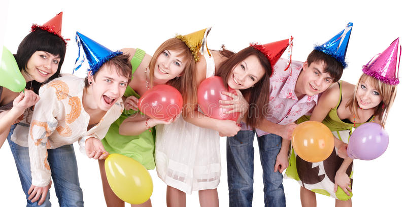 Group of teenagers celebrate birthday. Group of teenagers in party hat celebrate birthday. Isolated stock photo