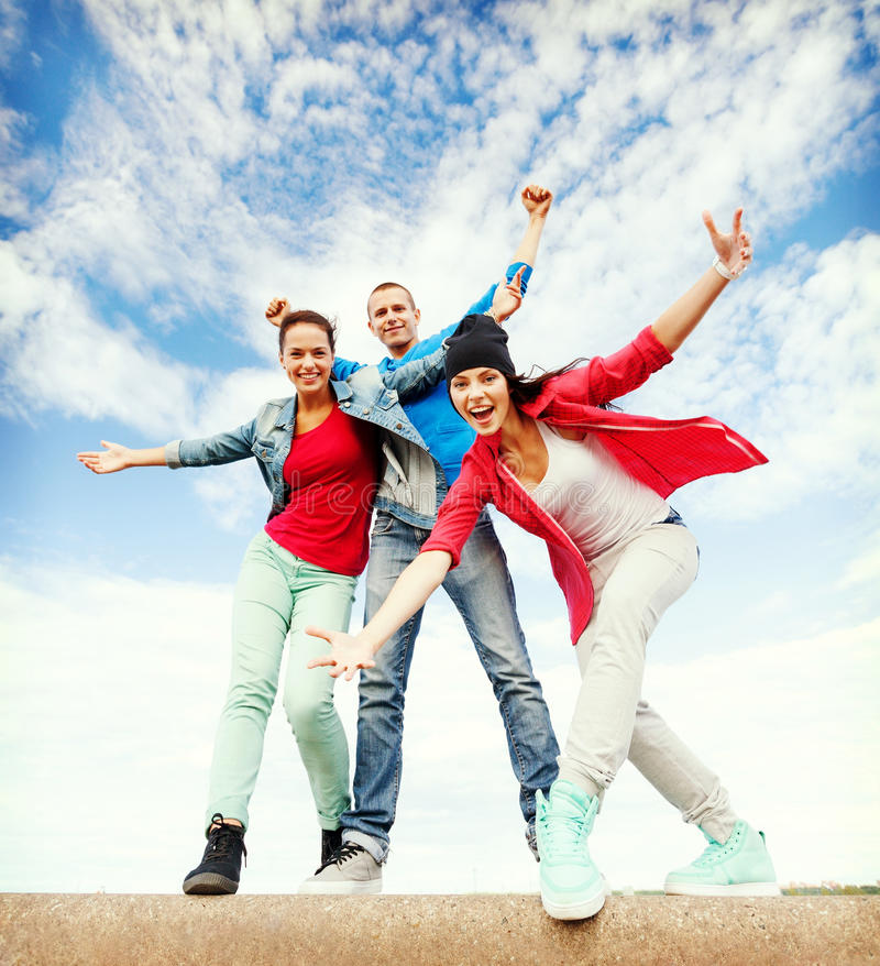 Group of teenagers dancing. Sport, dancing and urban culture concept - group of teenagers dancing royalty free stock photography