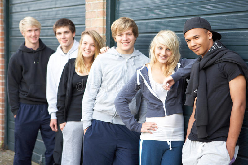 Group Of Teenagers Hanging Out Together Outside. Smiling royalty free stock photography